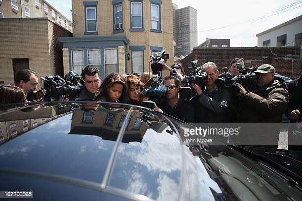The media surrounds Attorney Joseph Ginarte's car after he visited Alina Tsarnaeva, sister of accused Boston Marathon bombers Tamerlan and Dzhokhar...