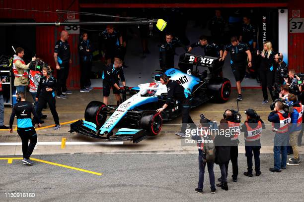 The media swarms around as George Russell of Great Britain driving the Rokit Williams Racing FW42 Mercedes waits in the Pitlane during day three of...