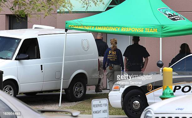 The medical examiner van is parked outside the dorm building as FBI evidence response team arrives Monday March 18 in Orlando after police found a...