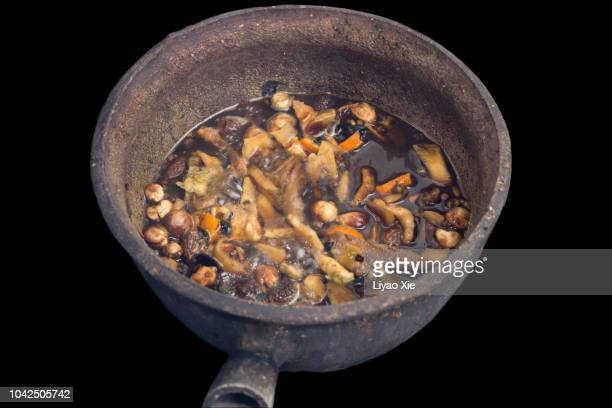 the medicine is ready for boiling. - liyao xie stock pictures, royalty-free photos & images