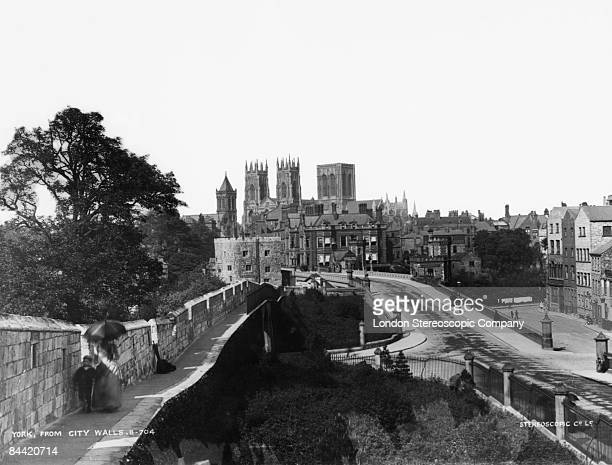 The medieval city walls around the old part of York in North Yorkshire, with York Minster in the background, circa 1890.