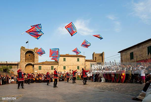 The Medieval Festival Monteriggioni wears a Crown of Towers, which takes place in July, flag wavers