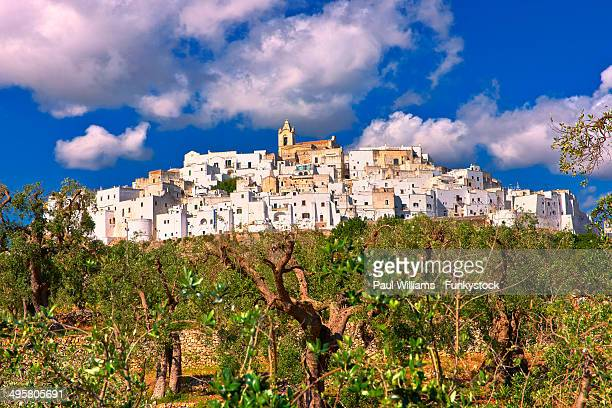 the medieval fortified hill town of ostuni, also la citta bianca, the white town, ostuni, apulia, italy - ostuni stock photos and pictures