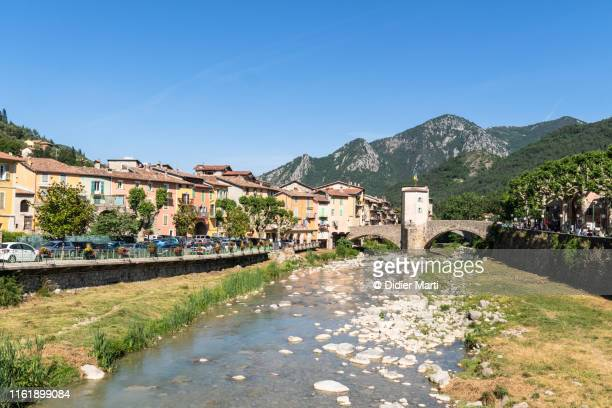 the medieval old town of sospel with its famous old bridge in the alpes-maritimes - alpes maritimes stock pictures, royalty-free photos & images