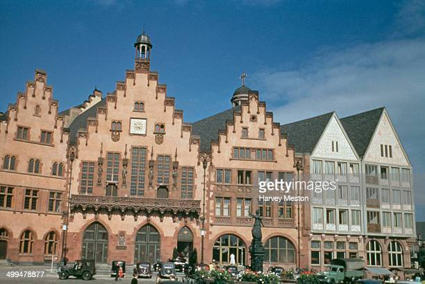 The medieval Römer building in the Römerberg square in the Altstadt of Frankfurt am Main Germany circa 1960 It was once used as a city hall In front...