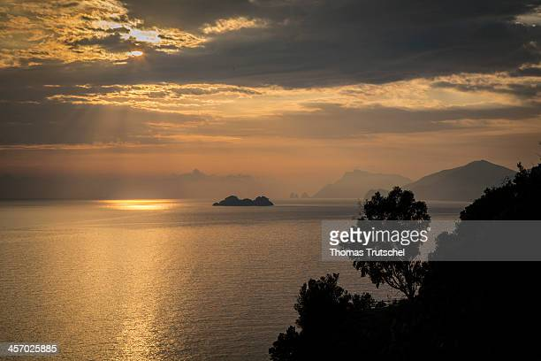 A the Mediterranean Sea and the sinking sun in the Campania region pictured on October 31 2013 in Praiano Italy