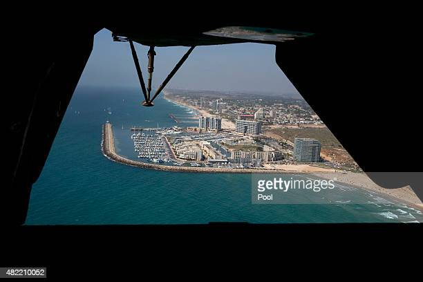 The Mediterranean Sea coast is seen from the rear of a helicopter transporting media and staff traveling with US Defense Secretary Ash Carter to Sde...