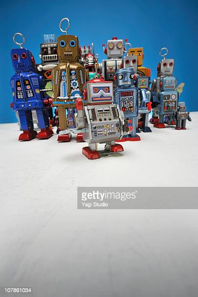 the meeting of the toy of the tinplate - wind up toy stock photos and pictures