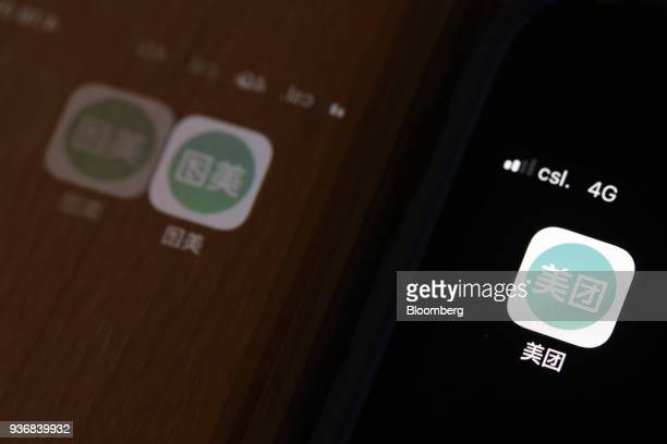 The Meituan application icon is displayed on an Apple Inc iPhone in an arranged photograph taken in Hong Kong China on Friday March 23 2018 Meituan...