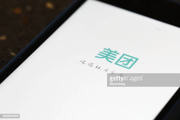 The Meituan Dianping logo is seen on the company's application on an Apple Inc iPhone in an arranged photograph taken in Hong Kong China on Friday...