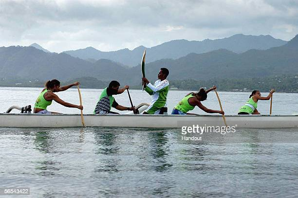 The Melbourne 2006 Commonwealth Games Queen's Baton is carried by canoe by Salome Tabualeuu January 9 2006 in Fiji Tabualeuu holds the record for...