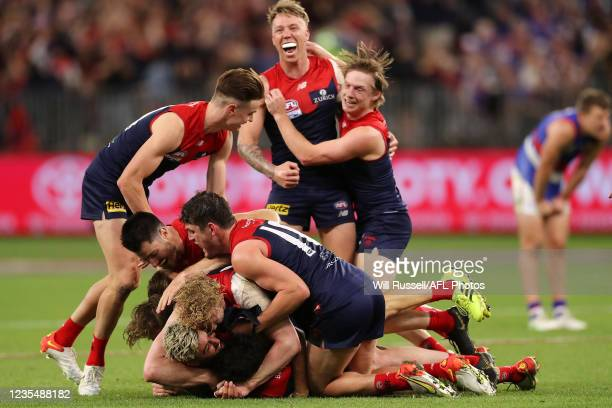 The Melbourne Demons celebrate after the teams win during the 2021 Toyota AFL Grand Final match between the Melbourne Demons and the Western Bulldogs...