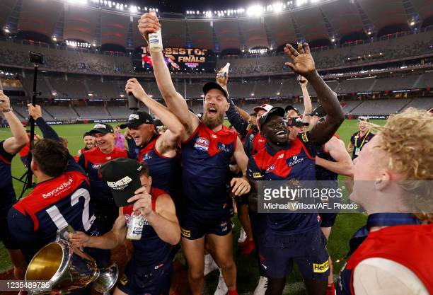 The Melbourne Demons team celebrate their victory with the Premiership Cup after the 2021 Toyota AFL Grand Final match between the Melbourne Demons...