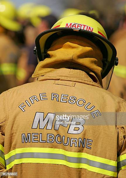 The Melbourne Fire Rescue logo is seen on a firefighters uniform as firefighters take part in the 'More Firefighters Not Less Rally' at Parliament...