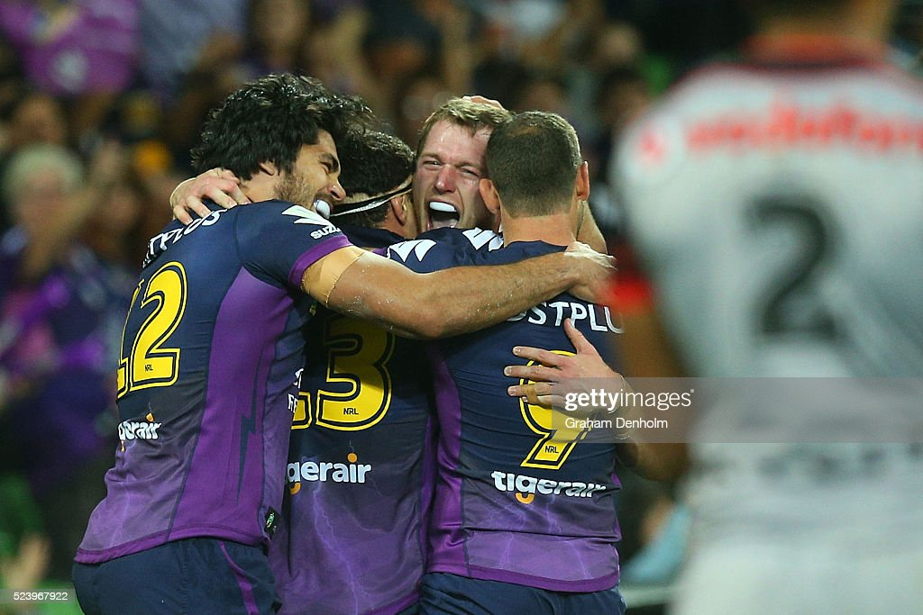 The Melbourne Storm celebrate a try during the round eight NRL match between the Melbourne Storm and the New Zealand Warriors at AAMI Park on April 25, 2016 in Melbourne, Australia.