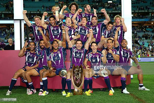 The Melbourne Storm celebrate on the podium after winning the 2012 NRL Grand Final match between the Melbourne Storm and the Canterbury Bulldogs at...