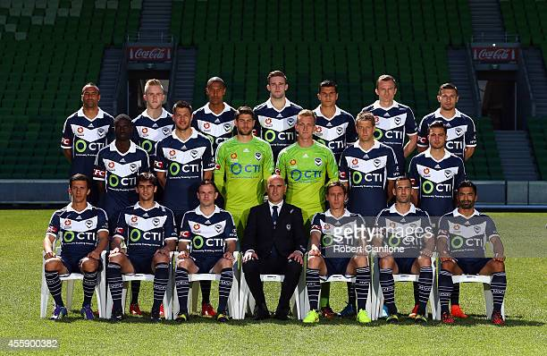 The Melbourne Victory pose in their home kit during the Melbourne Victory 2014/15 ALeague headshots session at AAMI Park on September 22 2014 in...