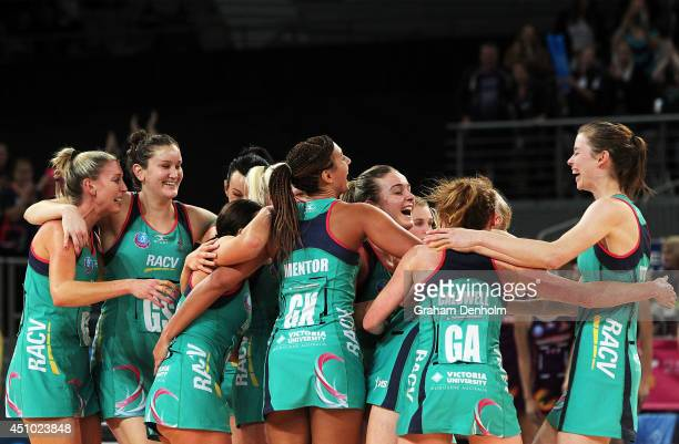 The Melbourne Vixens embrace following victory in the ANZ Championship Grand Final match between the Vixens and the Firebirds at Hisense Arena on...