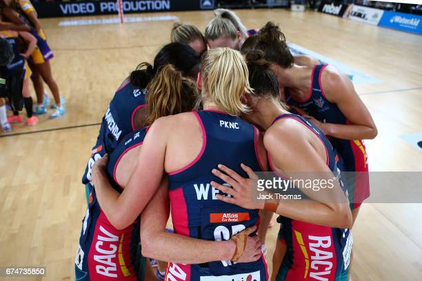 The Melbourne Vixens huddle after their round 10 Super Netball win against the Lightning at Margaret Court Arena on April 29 2017 in Melbourne...