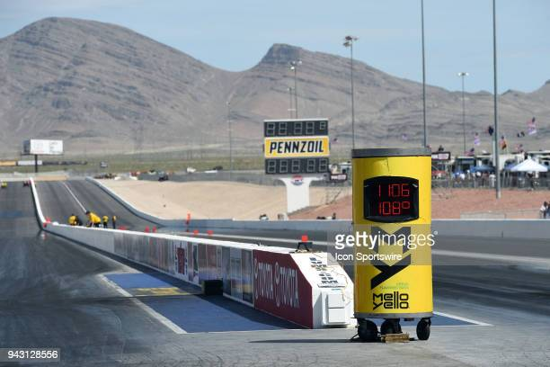 The Mello Yello clock and track temperature monitor sits near the starting box of the Pennzoil lane during the DENSO Spark Plugs NHRA FourWide...