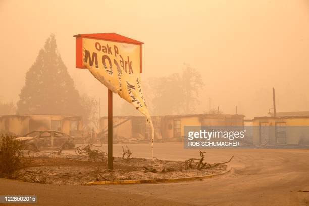 The melted sign of the Oak Park Motel destroyed by the flames of the Beachie Creek Fire is seen in Gates, east of Salem, Oregon on September 13,...