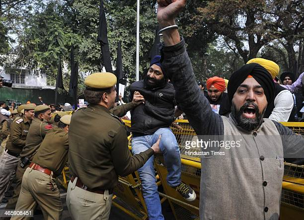 The members of Akali Dal and other Sikh organizations protest outside AICCI Akbar Road office demanding that the names of the party leaders involved...
