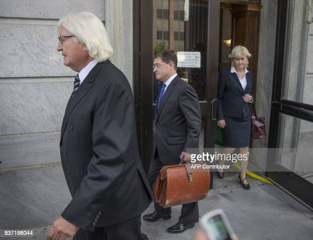 The members of Bill Cosbys legal team Tom Mesereau Sam Silver and Kathleen Bliss leave the Montgomery County Courthouse on August 22 2017 in...
