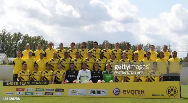 The members of German first division Bundesliga football club Borussia Dortmund physiotherapist Thomas Zetzmann physiotherapist Thorben Voeste kit...