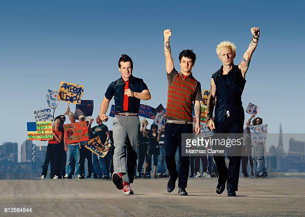 The members of Green Day march in protest of the Bush administration LR are Tre Cool Billie Joe Armstrong and Mike Dirnt