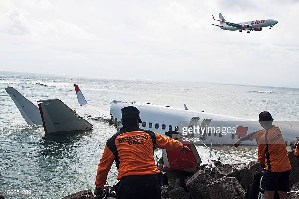The members of Indonesia Search and Rescue Agency prepare to search the CVR inside the wreckage of the Lion Air plane on April 15 2013 in Badung Bali...