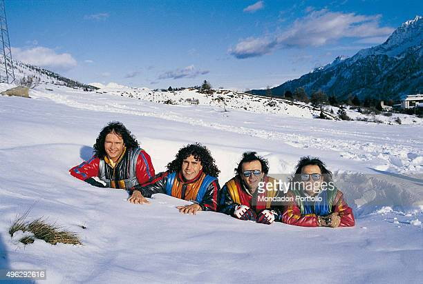 The members of Italian band Pooh laying on the snow at Passo del Tonale. From the left: Red Canzian , Stefano D'Orazio, Dodi Battaglia and Roby...
