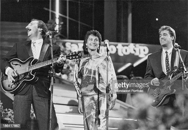The members of Italian band Ricchi e Poveri Franco Gatti Angela Brambati and Angelo Sotgiu performing on the stage of the 35th Sanremo Music Festival...