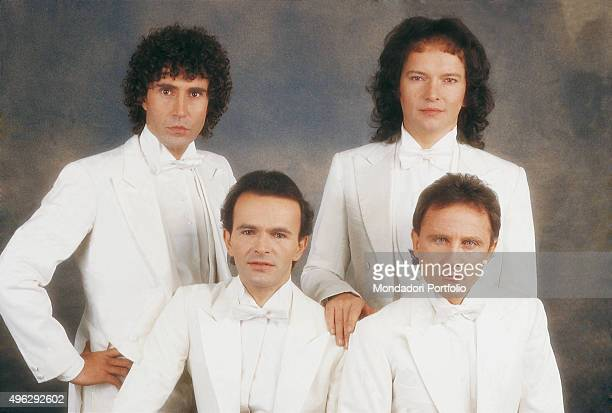 The members of Italian band The Pooh in white dinner suit for a Christmas photocall shooted at the studio From the left Stefano D'Orazio Red Canzian...