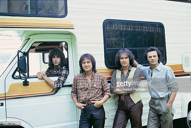 The members of Italian band The Pooh posing beside a camper van in a photocall. From the left Stefano D'Orazio , Roby Facchinetti , Red Canzian ,...