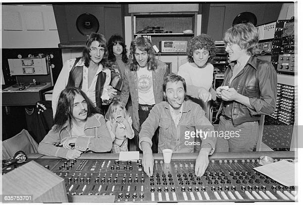 The members of Jefferson Starship goof off and eat pizza as they record their album Earth