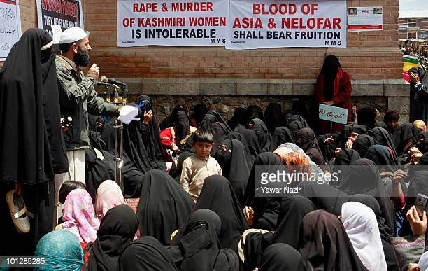 The Members of MajlisEMashawarat address Kashmir Muslim women attending a sitin protest outside the Jamia Mosque on the first anniversary of the rape...