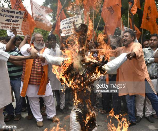 The members of Rashtrya Wadi Sena burning the effigy of Terrorism and protesting against the Amar Nath Yatra attack at Jantar Mantar on July 13 2017...