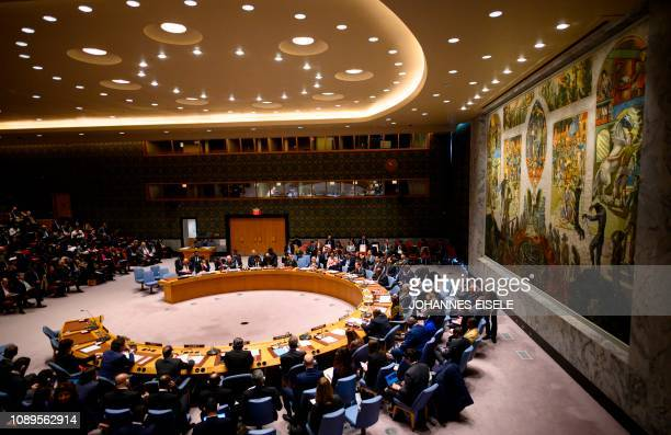 The members of the a United Nations Security Council meeting sit together on January 26 2019 at the United Nations in New York during a session on...
