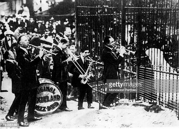 The members of the American 'Original Dixieland Jazz Band' testing the effects of syncopation on a polar bear caged in a zoo New York 1920s