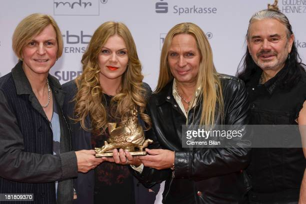 The members of the band Silly Ritchie Barton Anna Loos Uwe Hassbecker and Jaecki Reznicek pose with their award at the Goldene Henne 2013 award at...