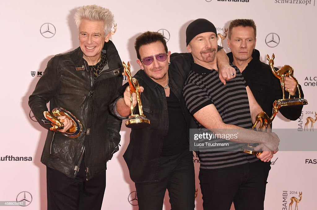 The members of the band U2, (L-R) Adam Clayton, Bono, The Edge and Larry Mullen junior, pose with their award during Kryolan at the Bambi Awards 2014 on November 13, 2014 in Berlin, Germany.