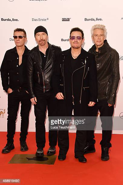 The members of the band U2 Larry Mullen junior The Edge Bono and Adam Clayton attend Kryolan at the Bambi Awards 2014 on November 13 2014 in Berlin...