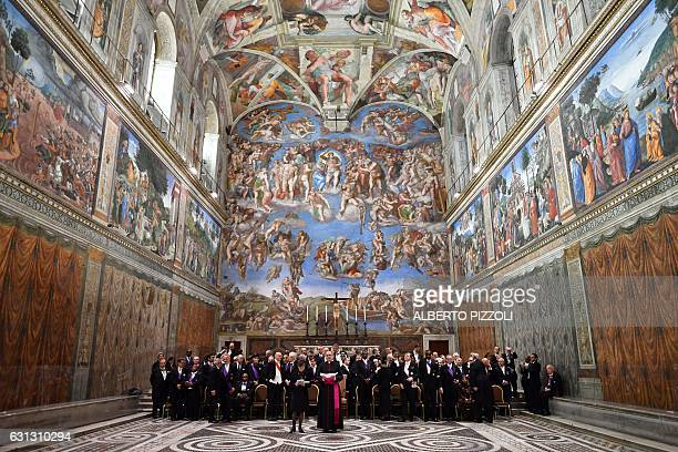 The Members of the Diplomatic Corps accredited to the Holy See stand in the Sistine Chapel during an audience with Pope Francis for the traditional...