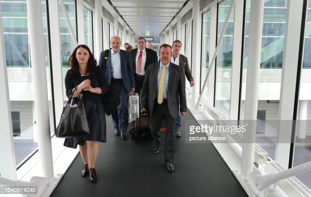 The members of the German defence committee Agnieszka Brugger Rainer Arnold Karl Lamers KarlHeinz Brunner and Alexander Neu walk along the gangway to...