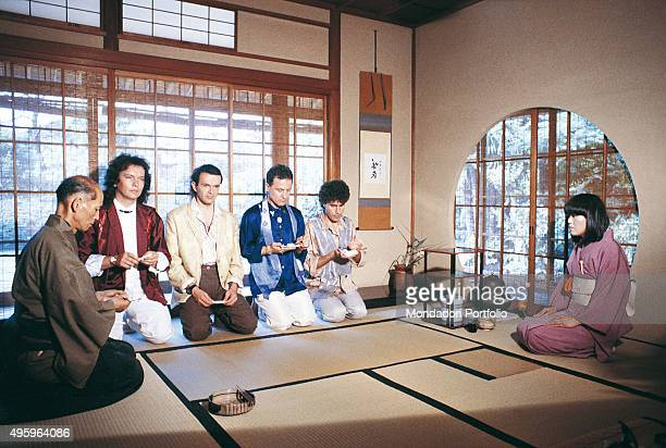 The members of the Italian band Pooh kneeling near a man and a woman during the Japanese tea ceremony, also called the way of tea. From the left: Red...