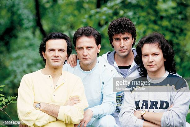 The members of the Italian band Pooh posing during a photo shoot From the left Dodi Battaglia Roby Facchinetti Stefano D'Orazio and Red Canzian Italy...