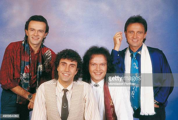 The members of the Italian band Pooh posing. From the left: Dodi Battaglia , Stefano D'Orazio, Red Canzian and Roby Facchinetti . Photo shoot. Italy,...