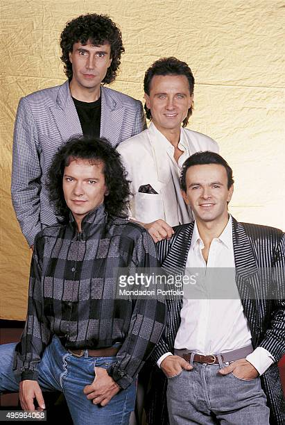 The members of the Italian band Pooh posing From the left on top Stefano D'Orazio Roby Facchinetti Dodi Battaglia and Red Canzian Photo shoot Italy...