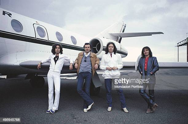 The members of the Italian band Pooh posing leaning against a wing of their plane From the left Stefano D'Orazio Dodi Battaglia Red Canzian and Roby...