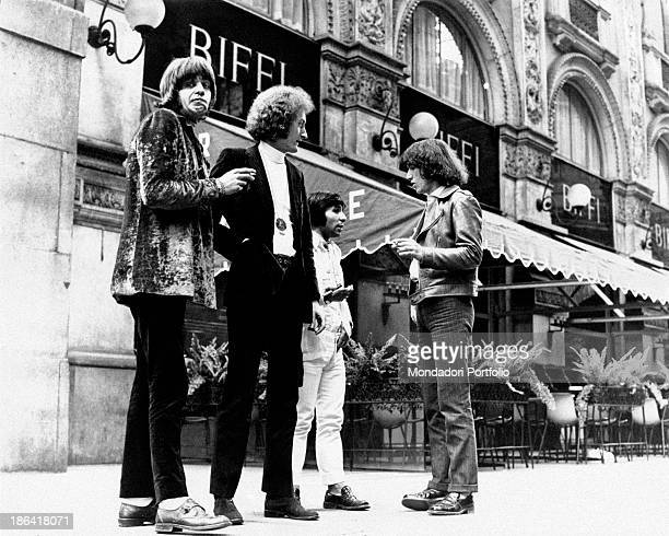 The members of the Italian music group Equipe 84 are chatting under the Galleria Vittorio Emanuele II shopping mall in Milan in front of the Café...